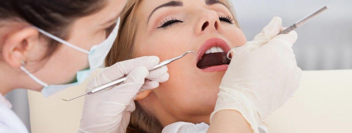 Лечение зубов в Омске цены